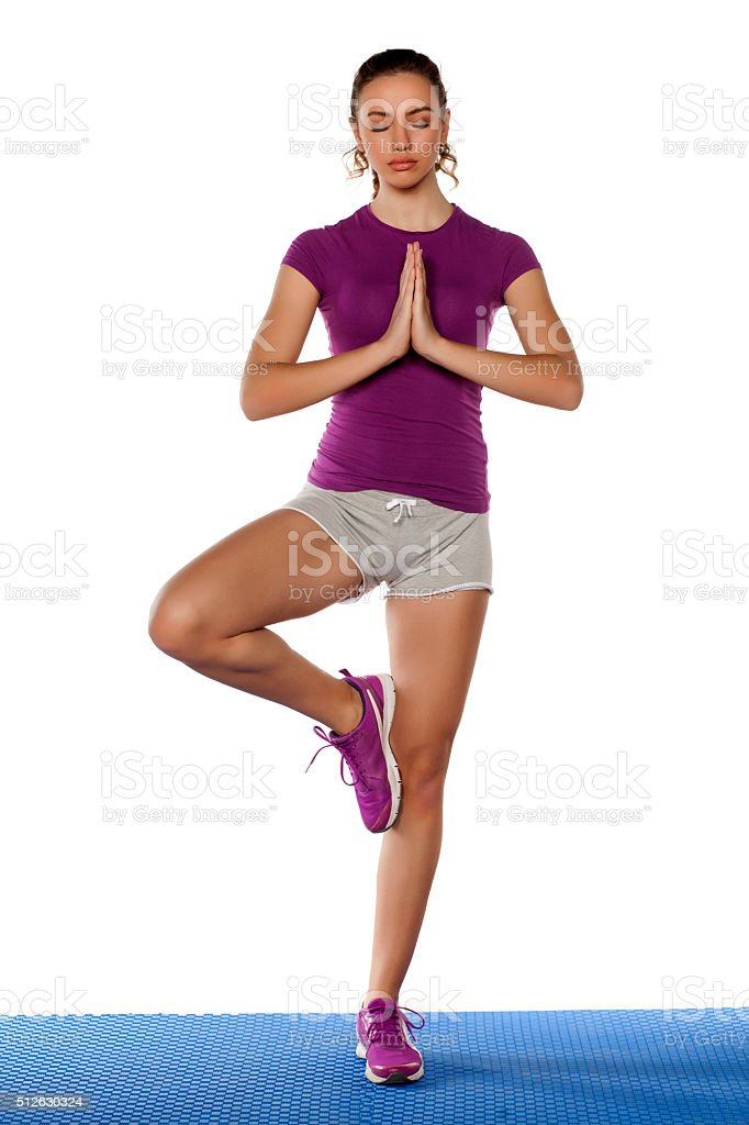woman in yoga pose stock photo