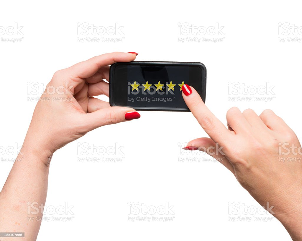Woman indicating 5 star rating on her smartphone stock photo