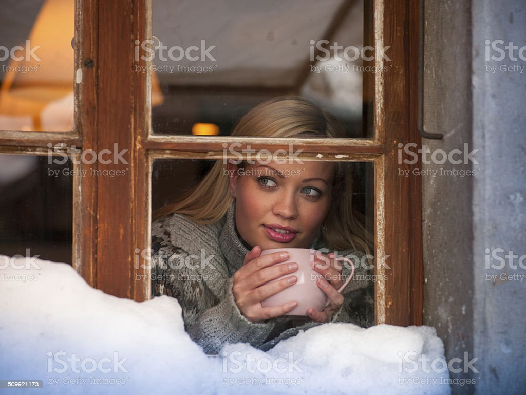 Woman Indoors at Winter stock photo
