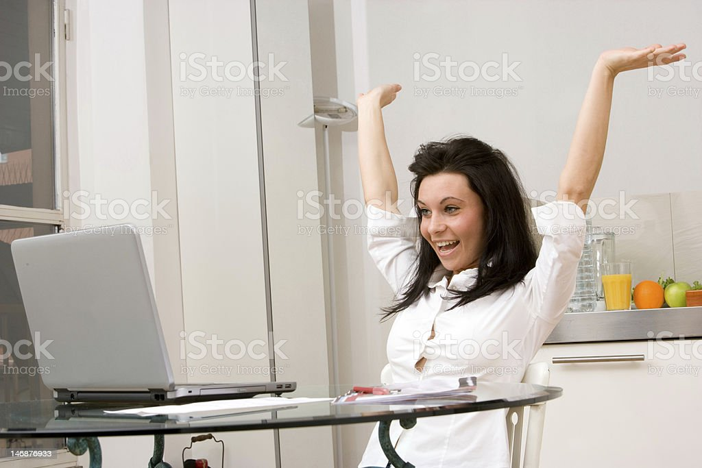woman indoors working with arms up royalty-free stock photo