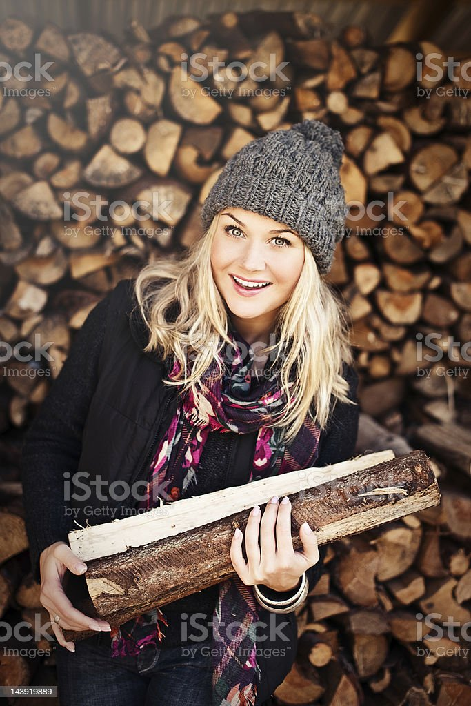 Woman infront of a woodpile royalty-free stock photo