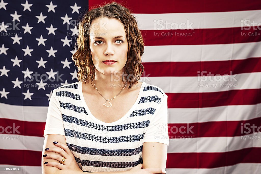 Woman infront of an american flag stock photo