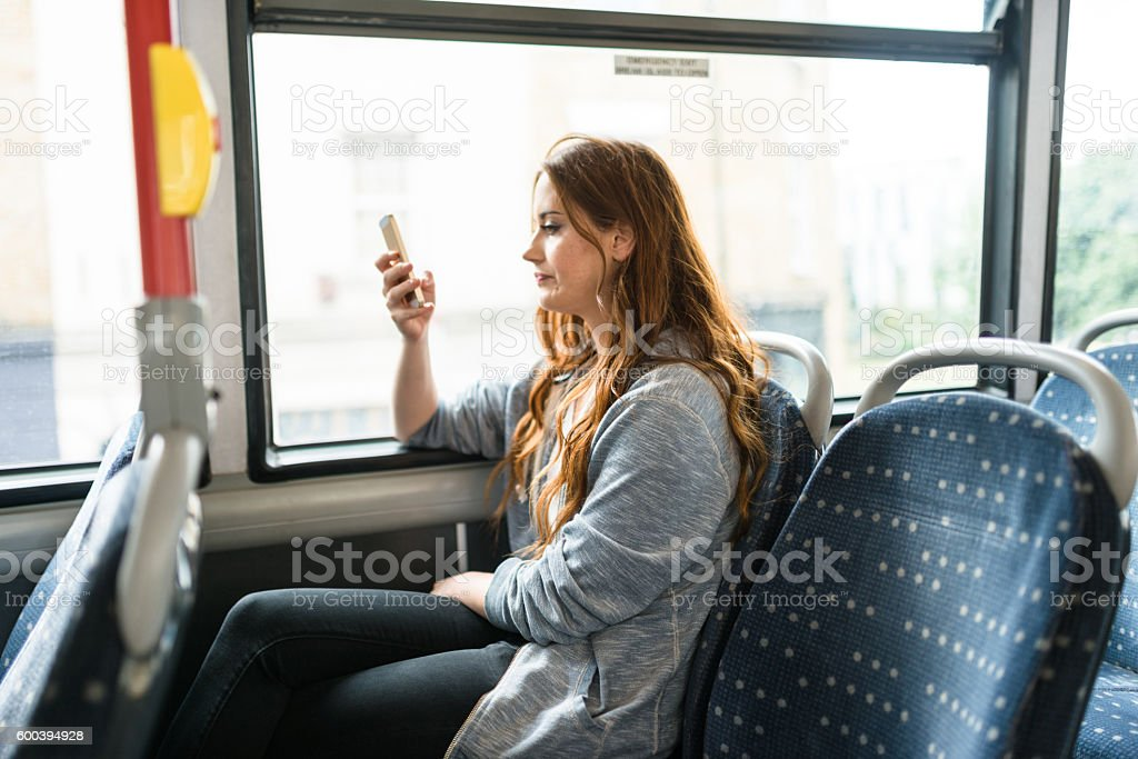 woman inside a bus in london on the phone stock photo