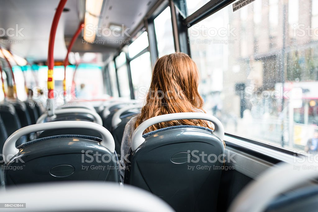 woman inside a bus in london travel alone stock photo
