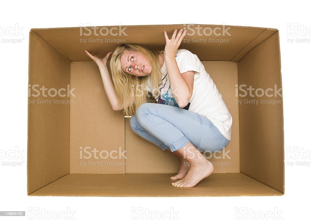Woman inside a Cardboard Box stock photo
