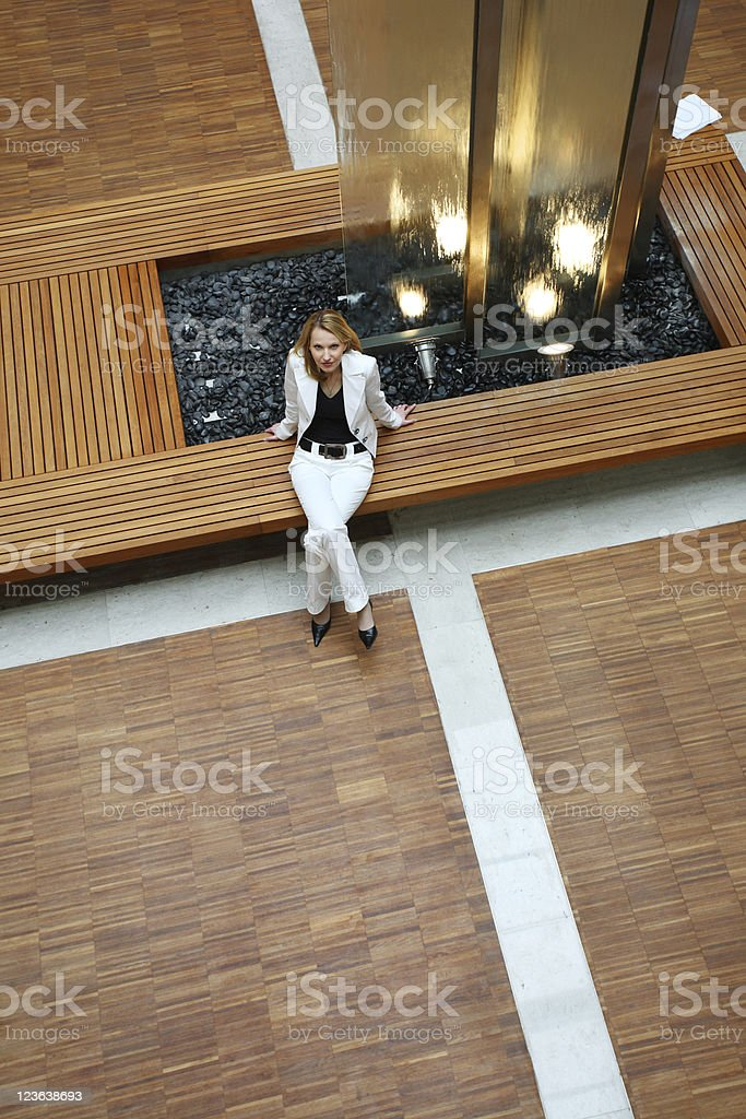 Woman inside a modern building stock photo