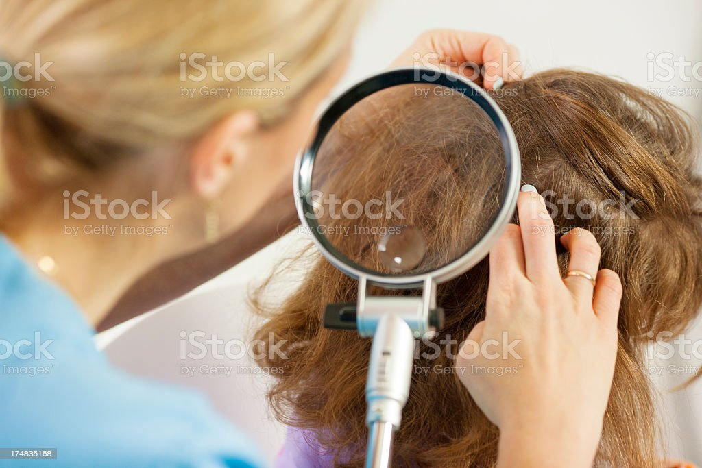 Woman inspect childs head for lice. stock photo