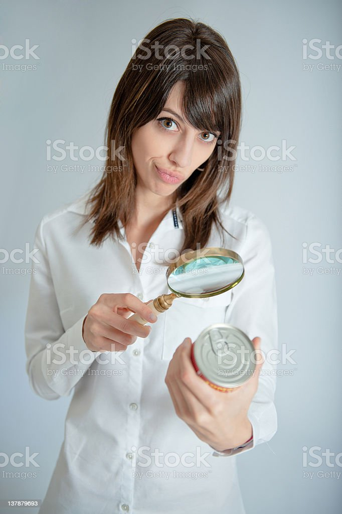 Woman inspecting nutrition label royalty-free stock photo