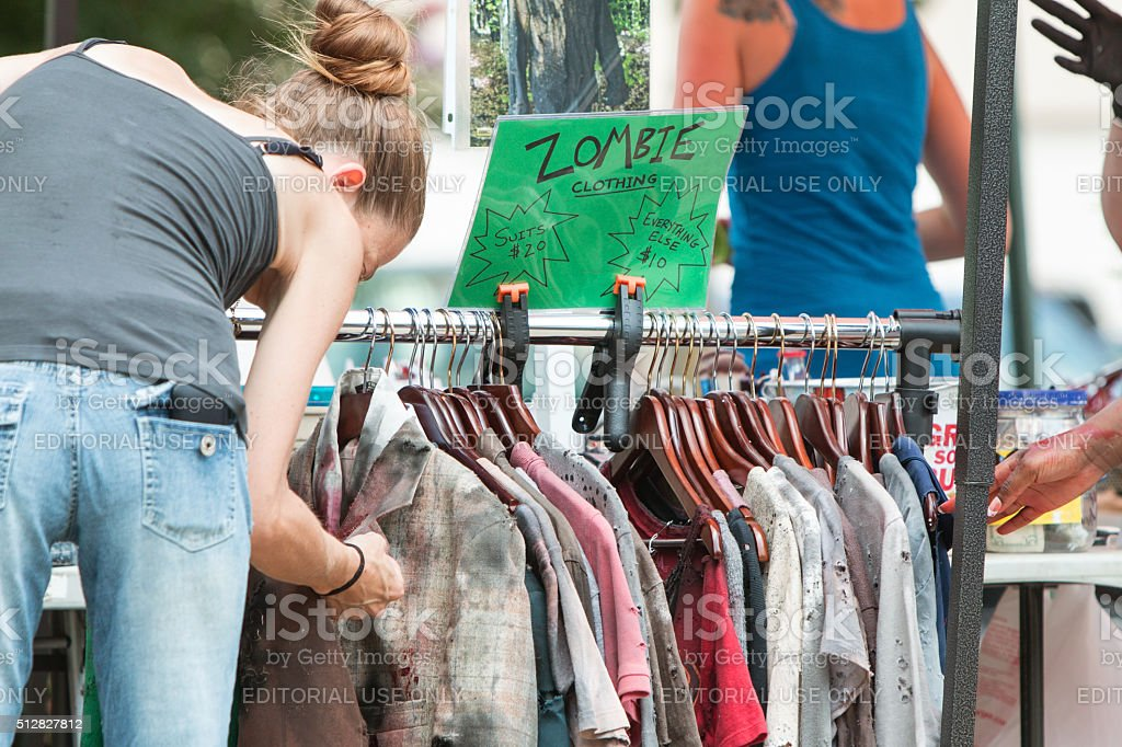 Woman Inspects Bloody Zombie Clothing Before Atlanta Pub Crawl stock photo