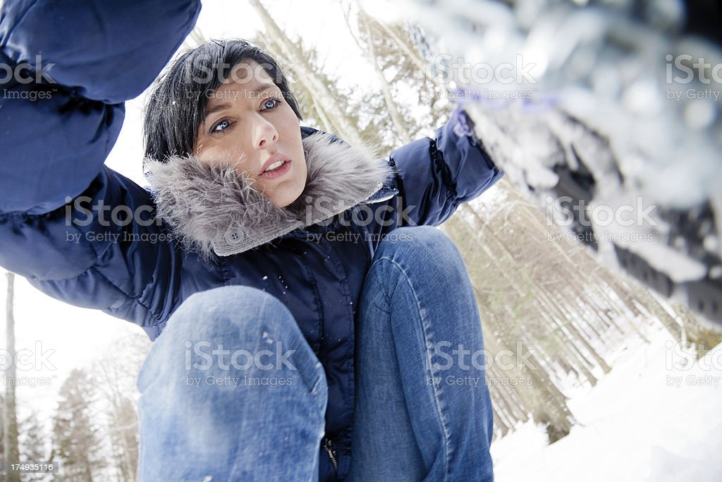 Woman installing snow chains royalty-free stock photo