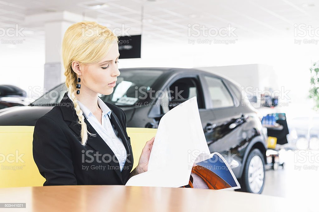 Woman interested in buying a new car stock photo