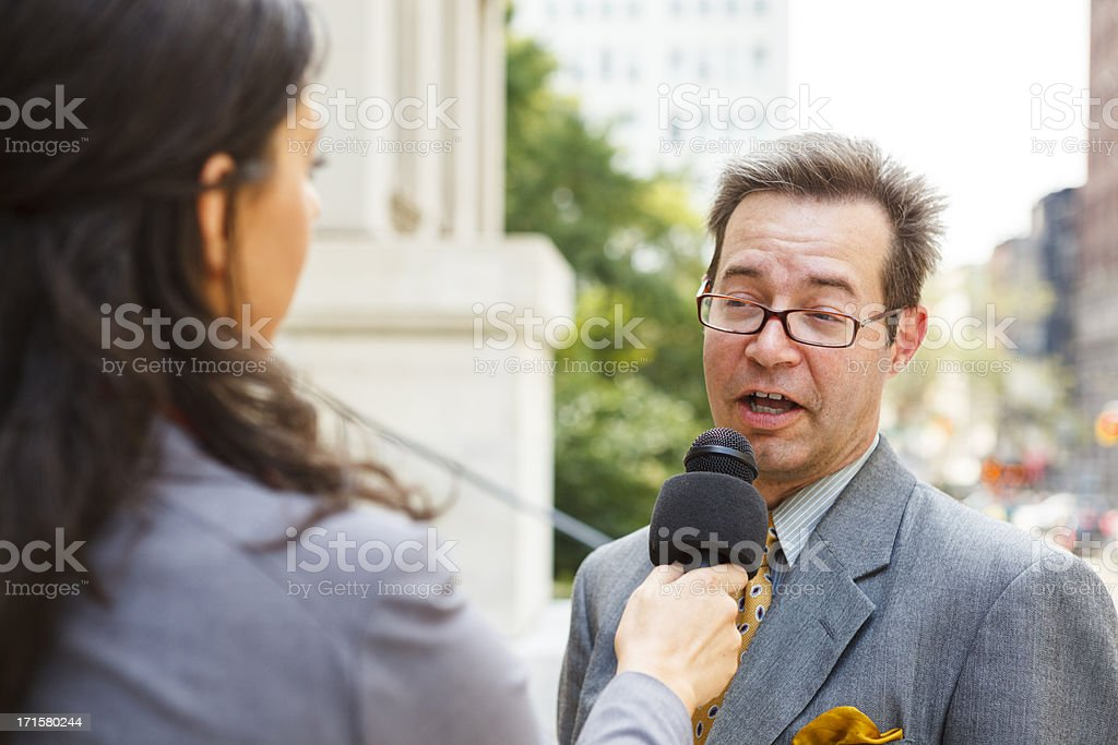 Woman Interviews Man stock photo