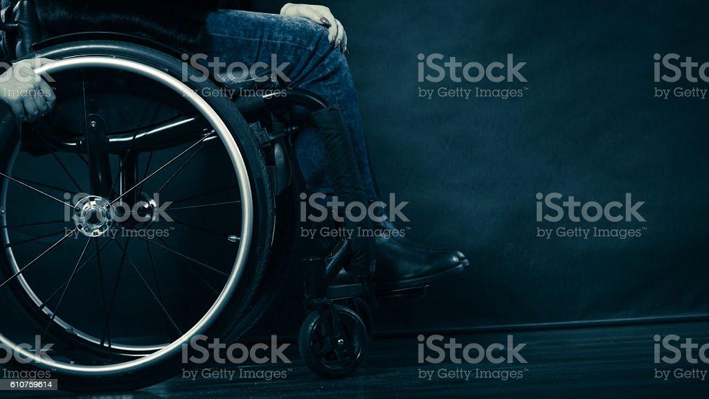 Woman invalid girl sitting on wheelchair stock photo