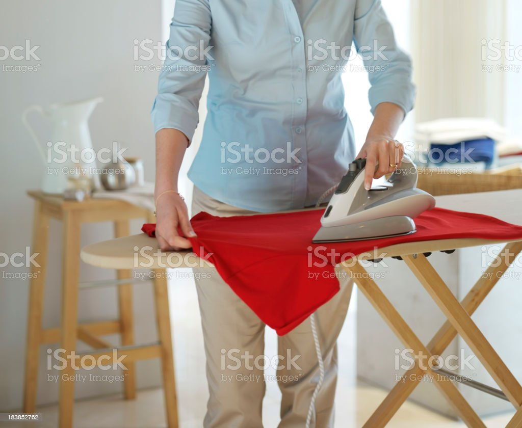 Woman ironing clothes. Housework. royalty-free stock photo