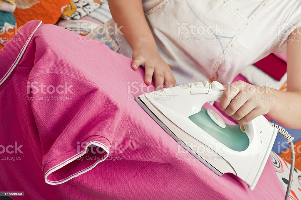 Woman Ironing Clothes royalty-free stock photo