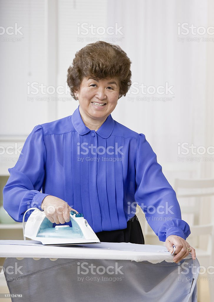 Woman ironing laundry royalty-free stock photo