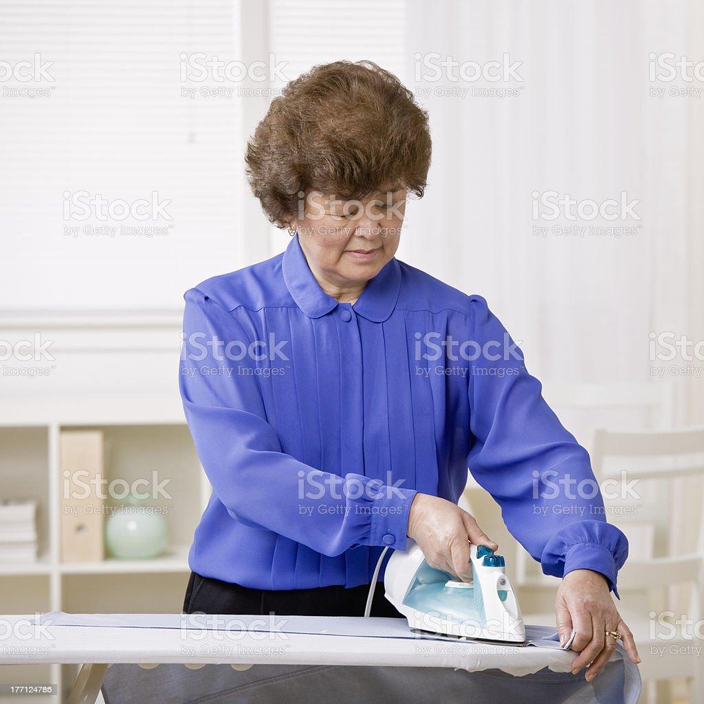 Woman ironing laundry royalty-free stock photo