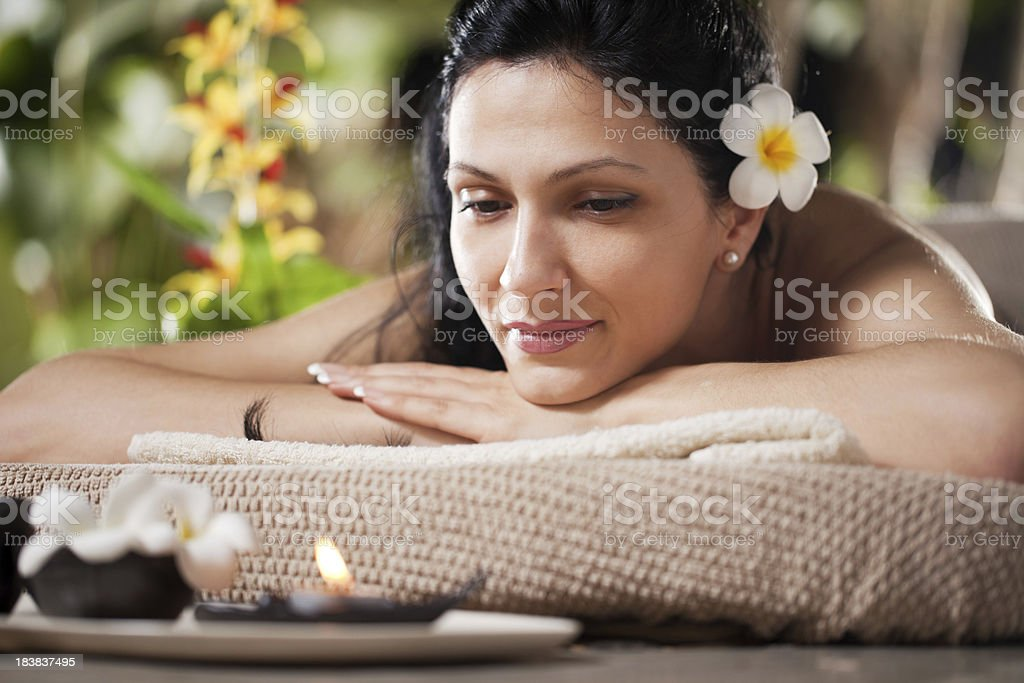 Woman is about to get massage at a tropical spa. royalty-free stock photo