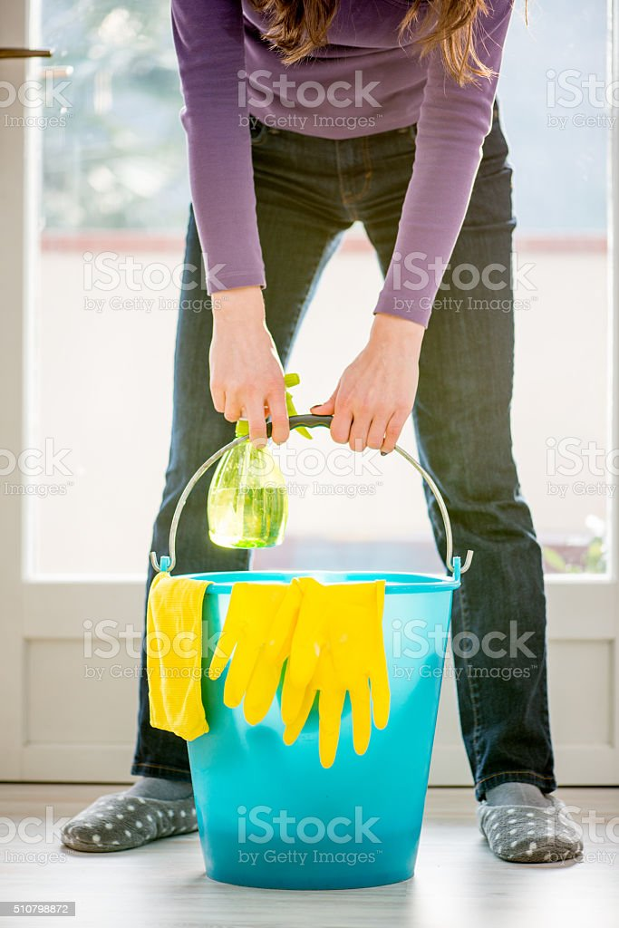 Woman is About to Lift Bucket to Wash Windows stock photo