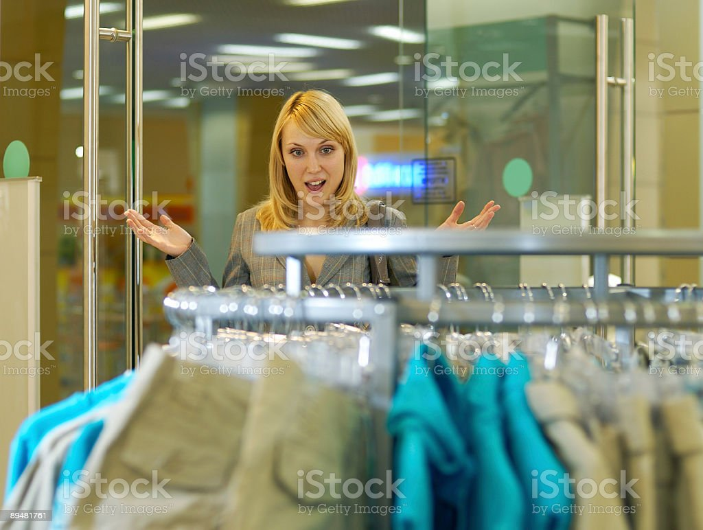 Woman is admired by clothes royalty-free stock photo