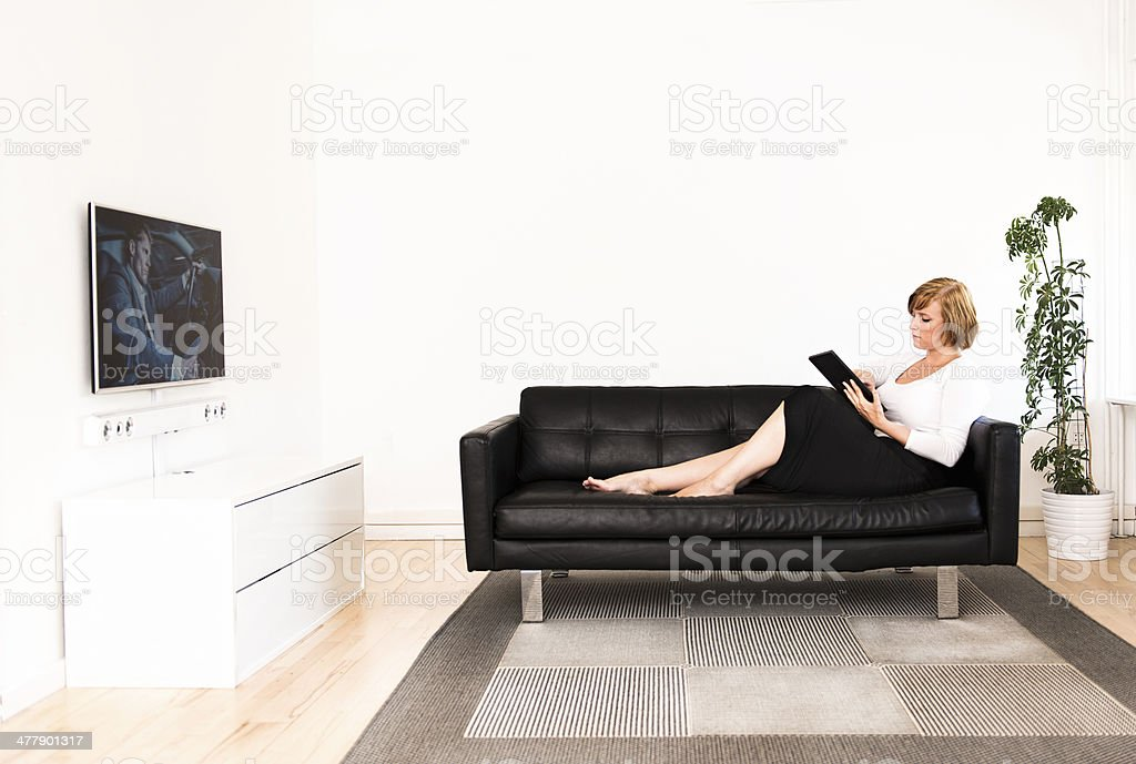 Woman is busy with digital tablet royalty-free stock photo