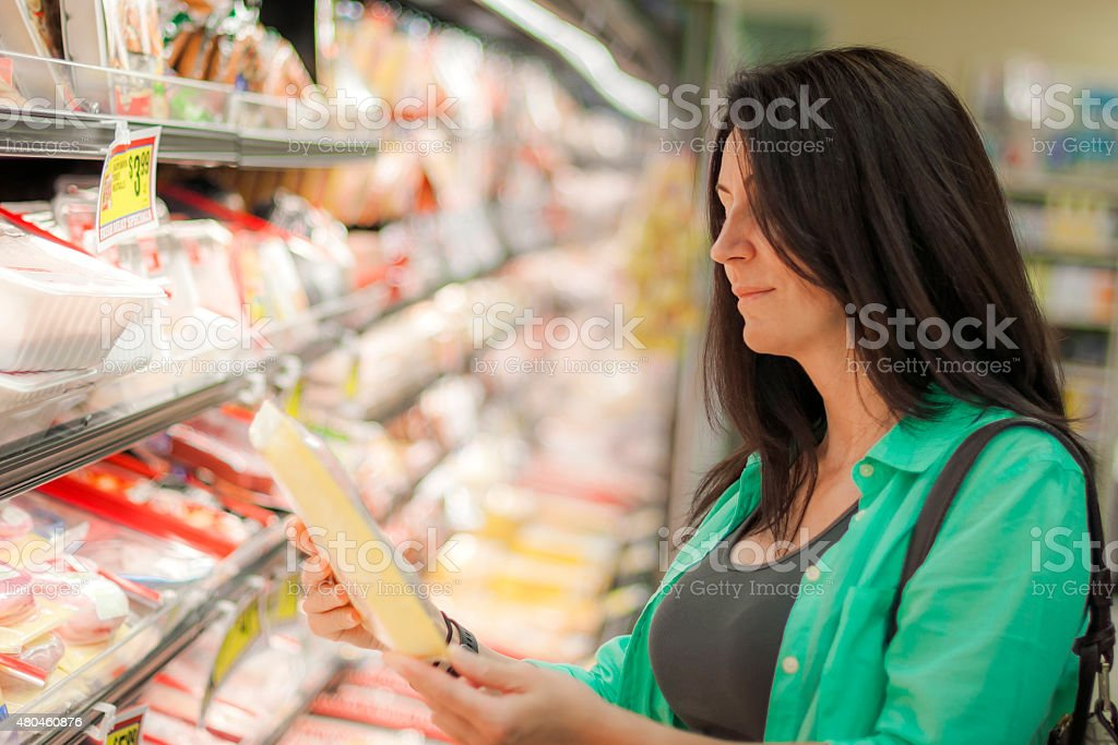 Woman is buying frozen meats stock photo