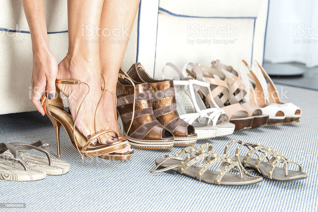 Woman is changing her shoes stock photo