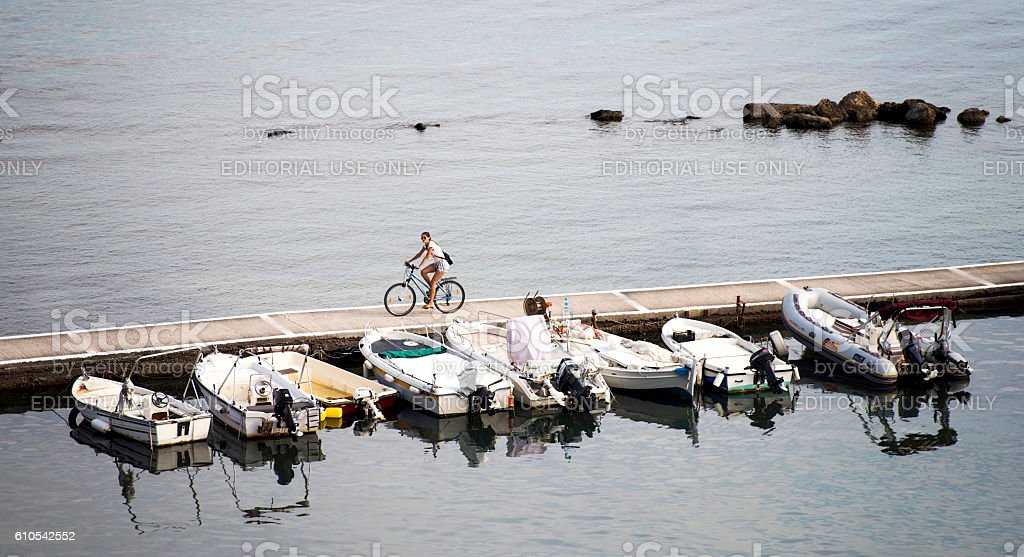 Woman is cycling at port stock photo