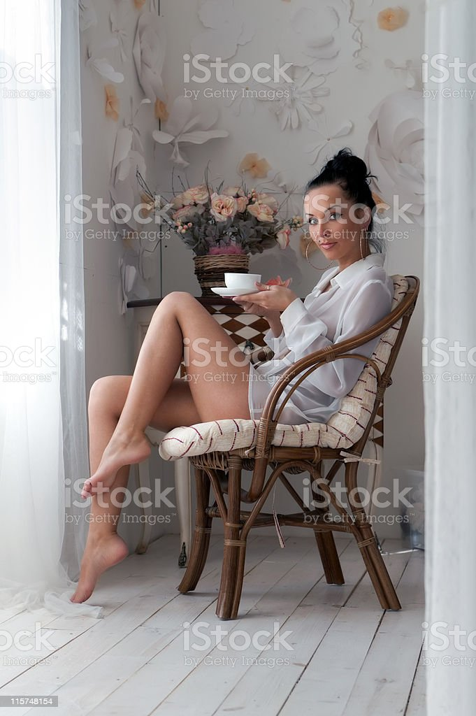 woman is drinking tea in the morning royalty-free stock photo