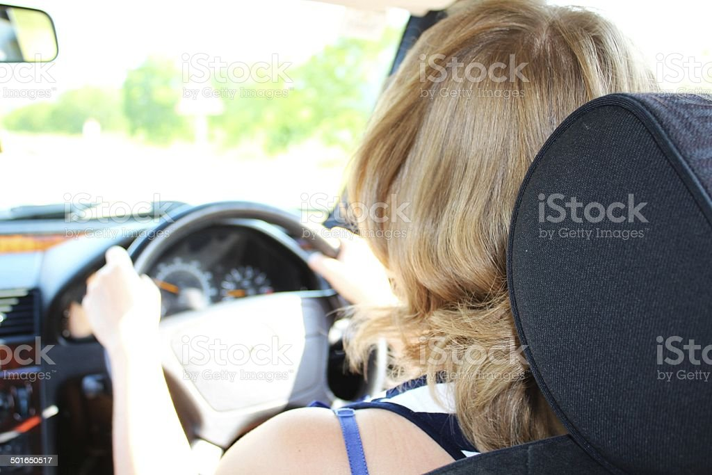 Woman is driving a car stock photo