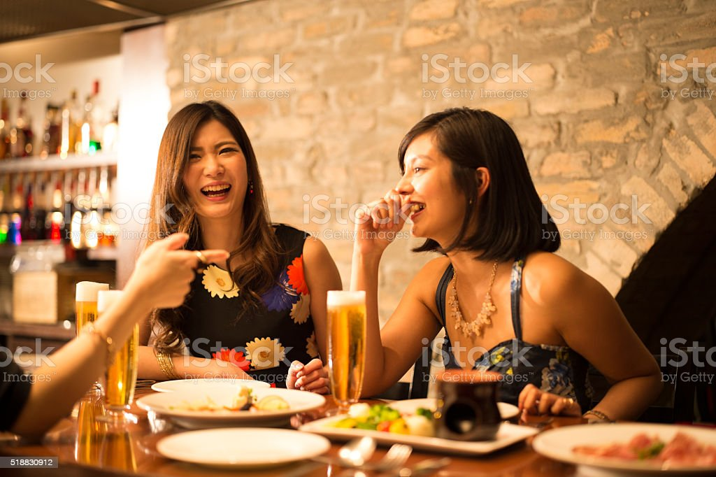 Woman is drunk are pointing in the restaurant stock photo