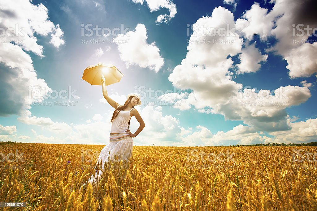 woman is enjoys summer day in the field royalty-free stock photo