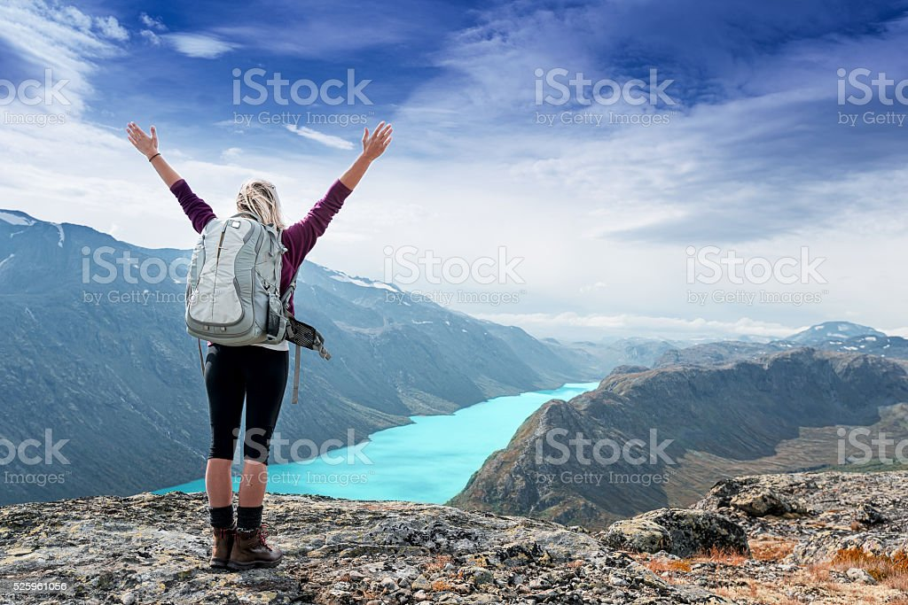 woman is feeling free and standing with hands up stock photo