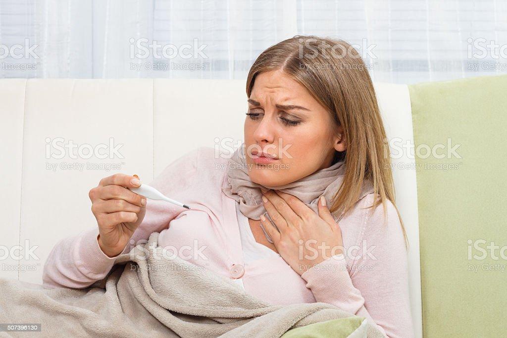 Woman is having sore throat stock photo