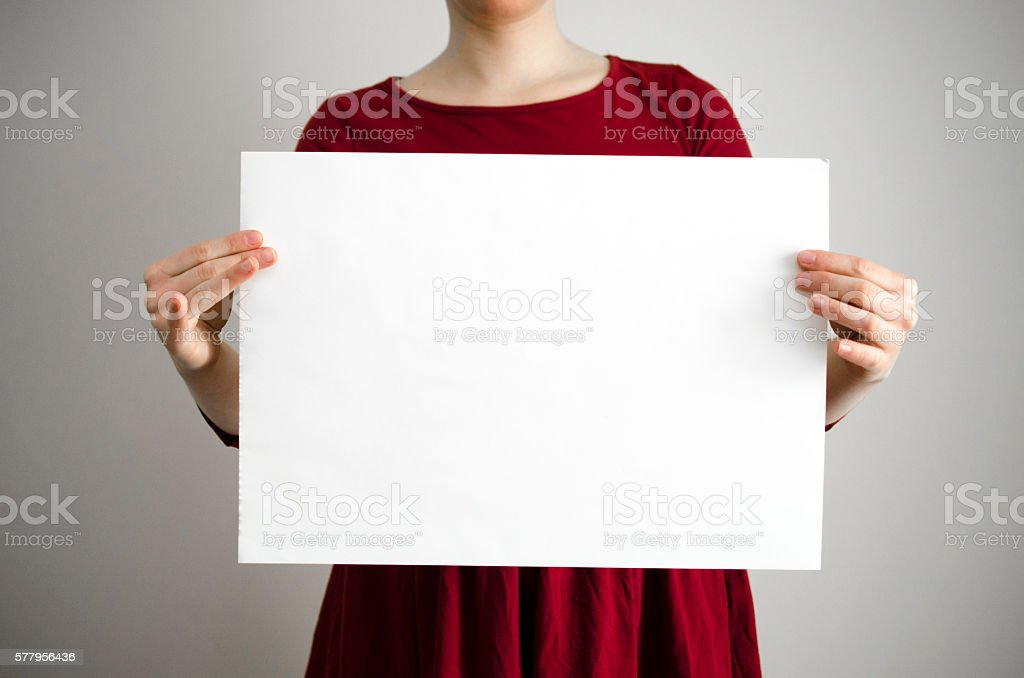 Woman is holding a blank placard sign with copy space stock photo
