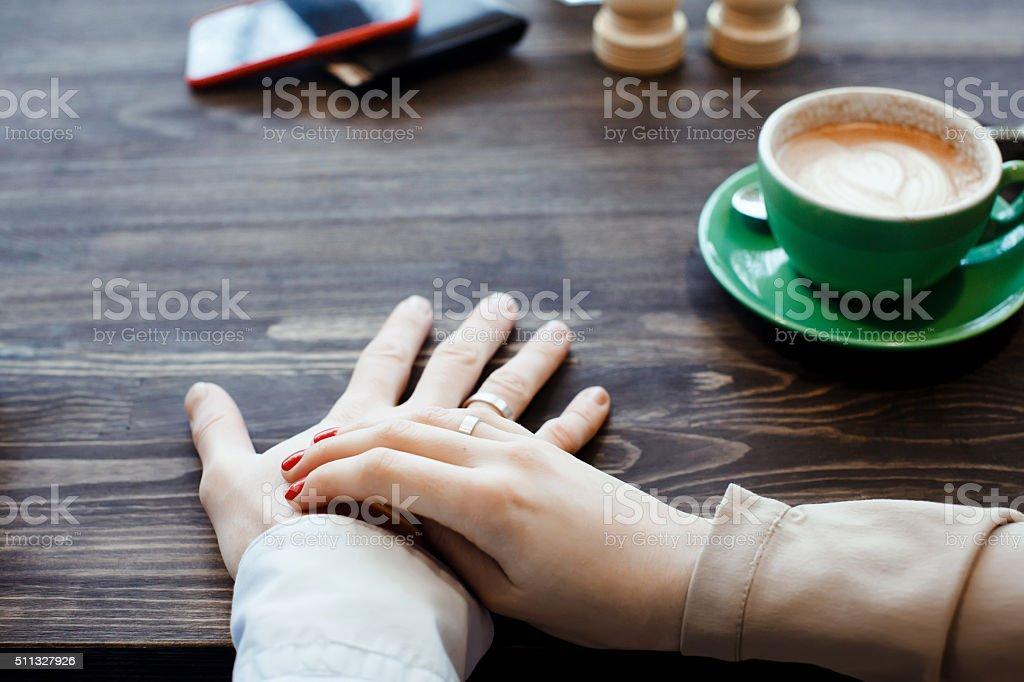 woman is holding her hands with a ring stock photo