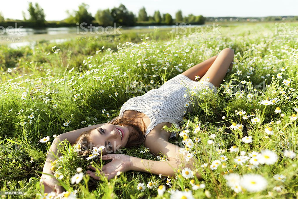 Woman is laying on the grass royalty-free stock photo