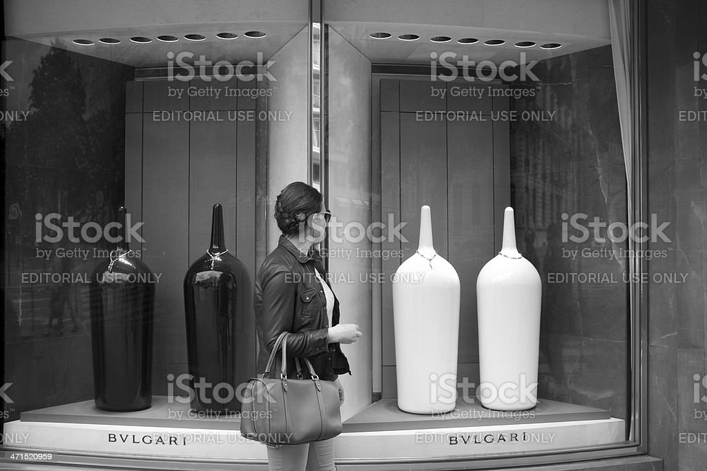 Woman is looking at window display of Jewellery stock photo
