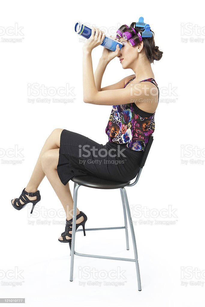 Woman is looking through a rolled up book stock photo