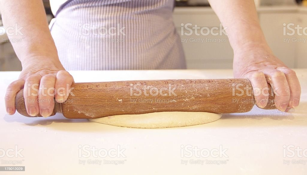 Woman is making dough royalty-free stock photo