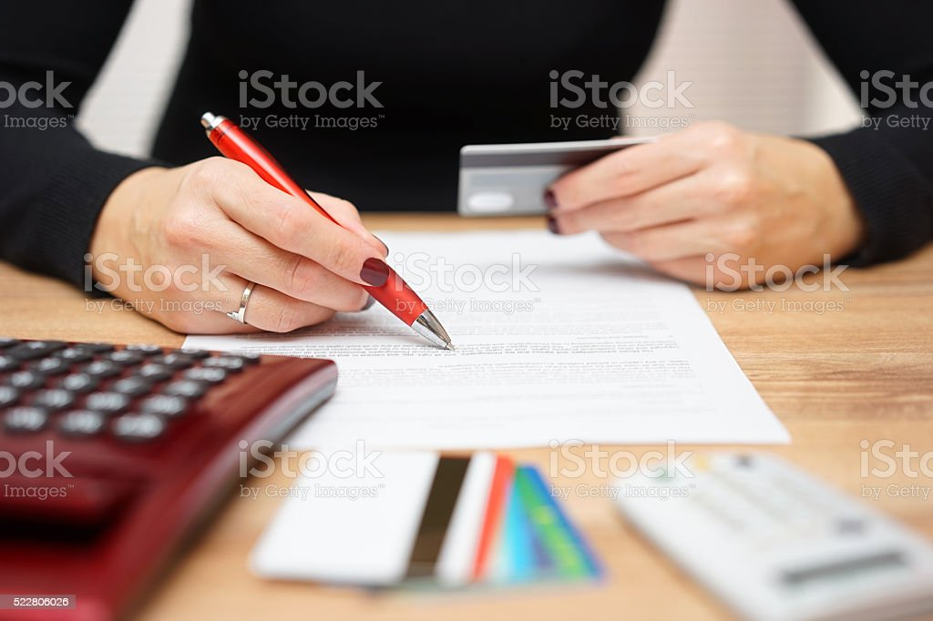 woman is opening bank account and checking  credit card informations stock photo