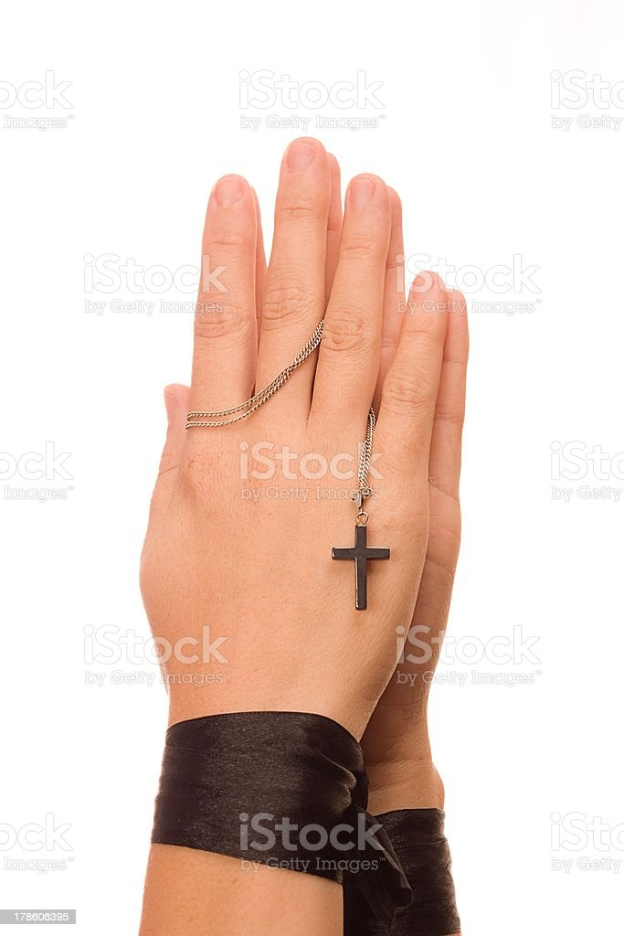 Woman is praying holding her cross. On white background. royalty-free stock photo