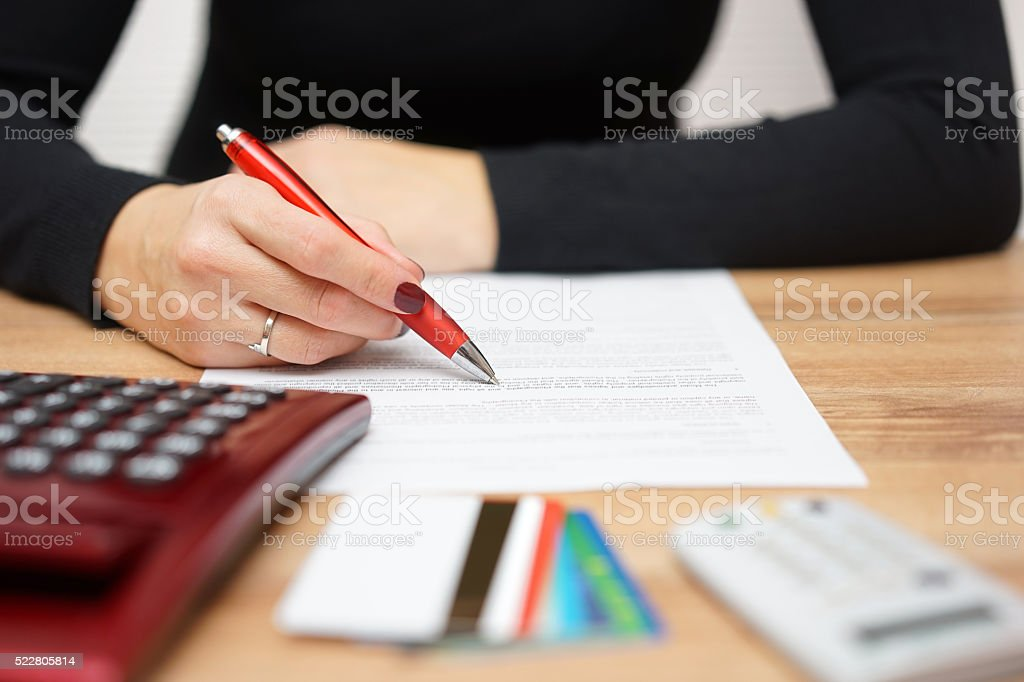 woman is reading bank notice about credit card spending stock photo