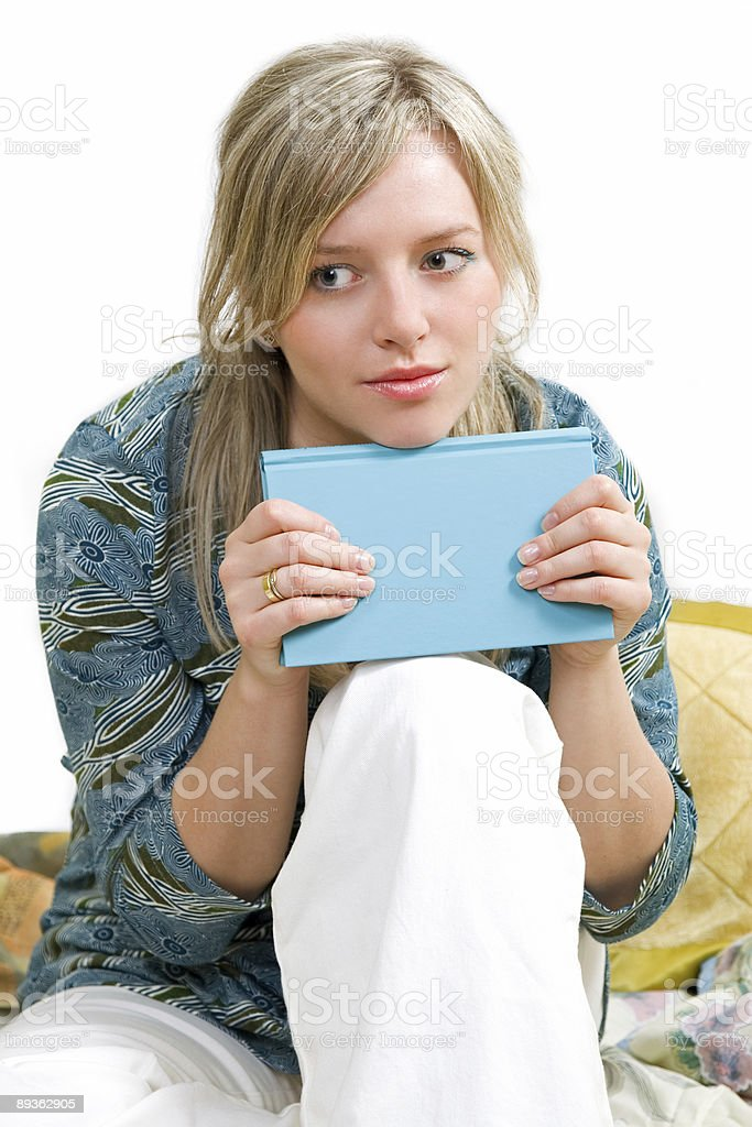 woman is reading books and thinking stock photo