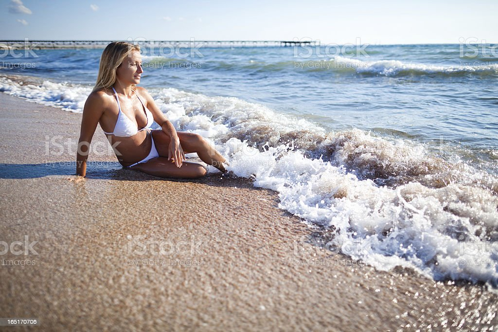 Woman is relaxing in tide waves royalty-free stock photo