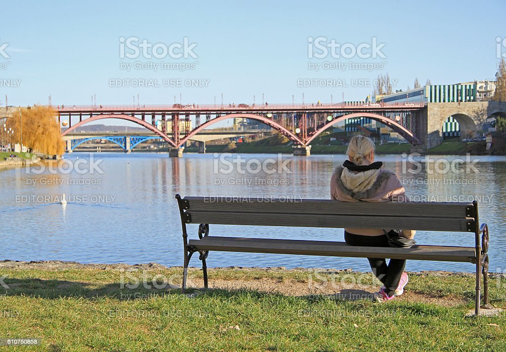 woman is resting on a bench in Maribor stock photo