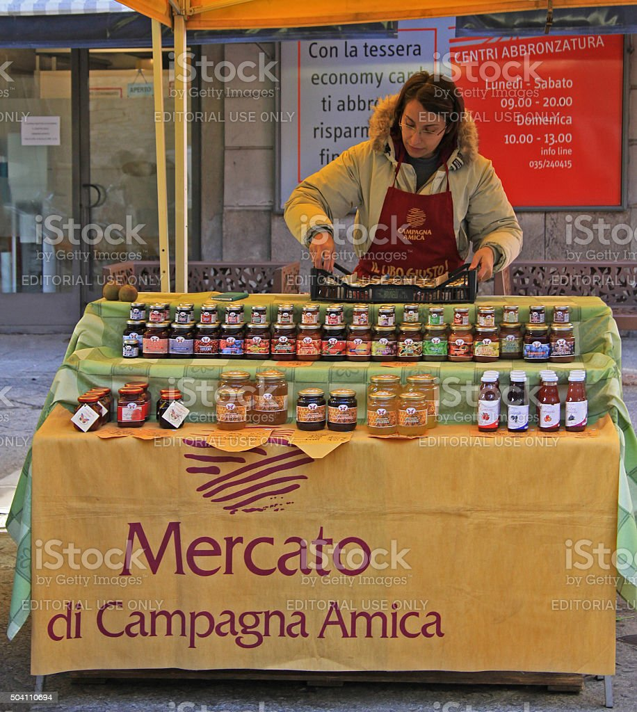 woman is selling jam at the fair in Bergamo stock photo