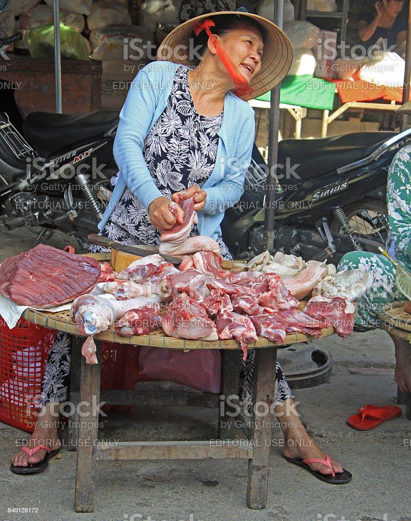 woman is selling meat on street market in Hue, Vietnam stock photo