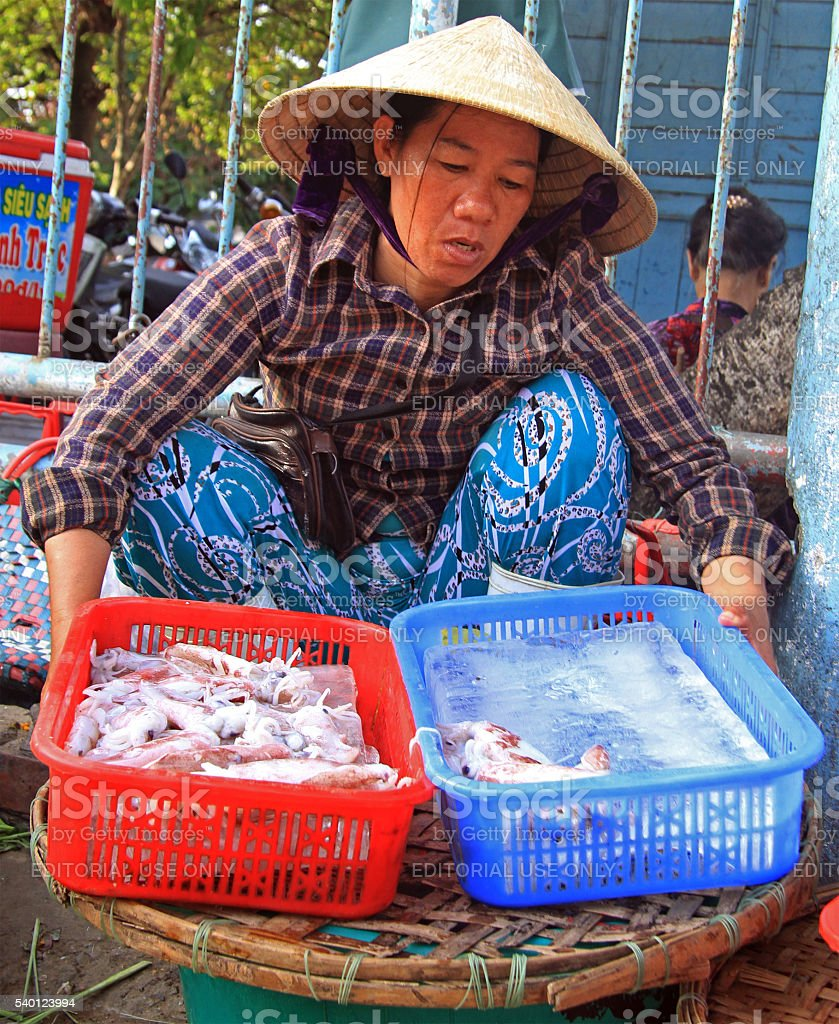 woman is selling seafood on street market in Hue, Vietnam stock photo