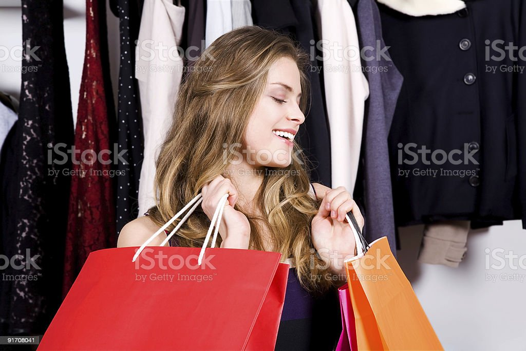 Woman is shopping and very happy royalty-free stock photo